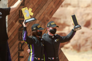 ALULA, SAUDI ARABIA - APRIL 04: Cristina Gutierrez (ESP)/Sebastien Loeb (FRA), X44 on podium with trophy during the Desert X-Prix at AlUla on April 04, 2021 in AlUla, Saudi Arabia. (Photo by Steven Tee / LAT Images)